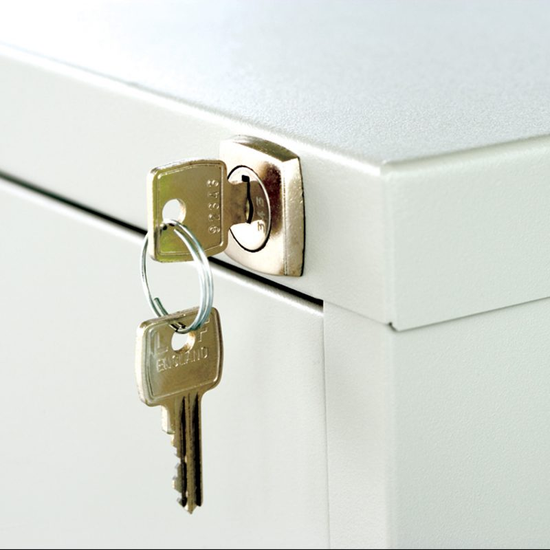 Close up of lock and key on filing cabinet