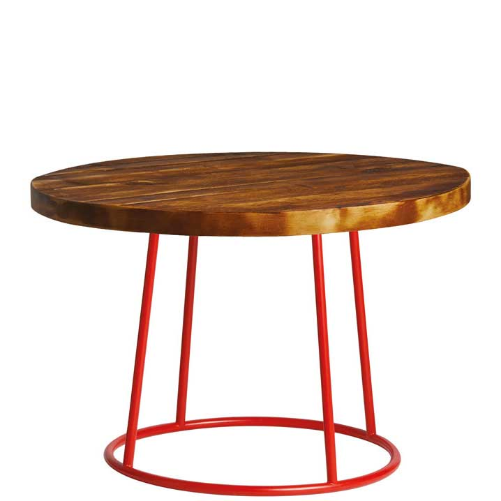 Round coffee table with dark wooden top and red legs