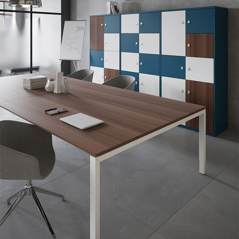 A wall of lockers with brown, white and blue doors behind a large meeting table