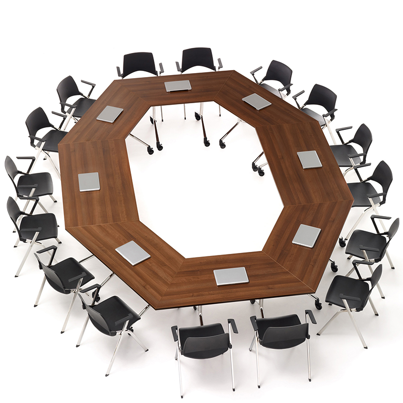 Overhead view of trapezium shaped tables, arranged in a circle with meeting chairs around them