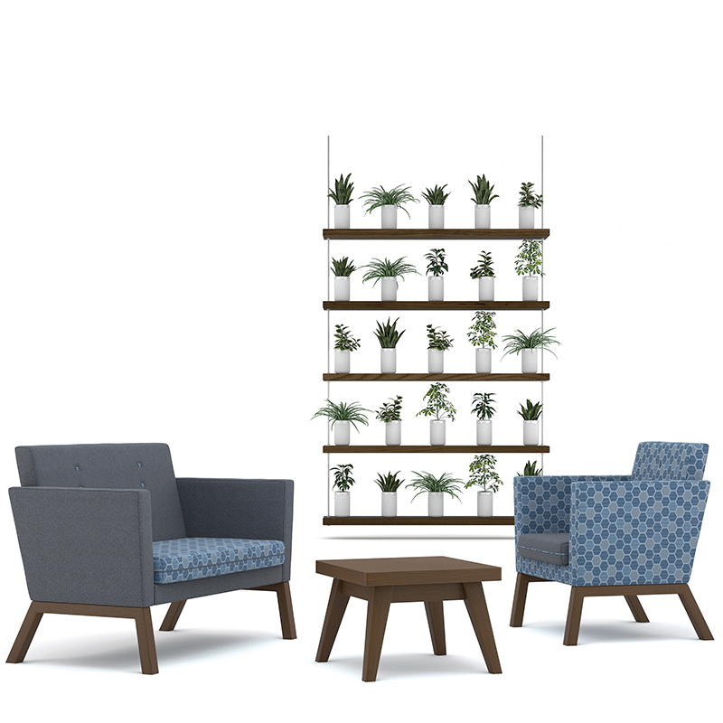 Square wooden table, dark blue sofa and blue geometric patterned armchair