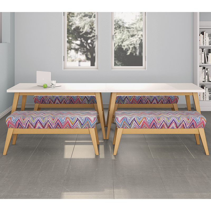 Patterned bench seating around a white wooden table
