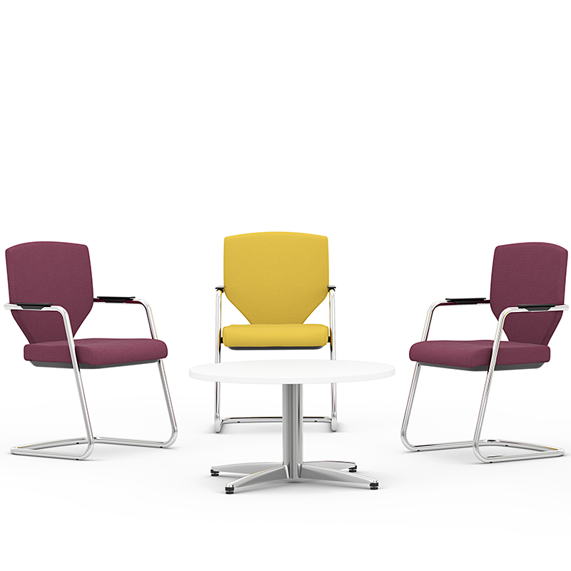 Three meeting chairs - two purple, one yellow - around a white coffee table