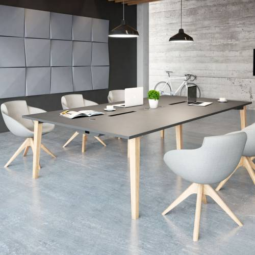 Grey tub-style chairs around a large black meeting table