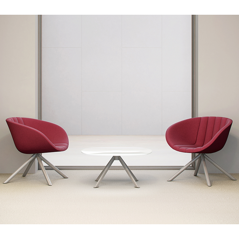 Two red tub chairs and a white coffee table
